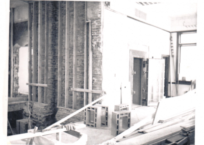Old bank being turned into the library, removing the wall - August 1968